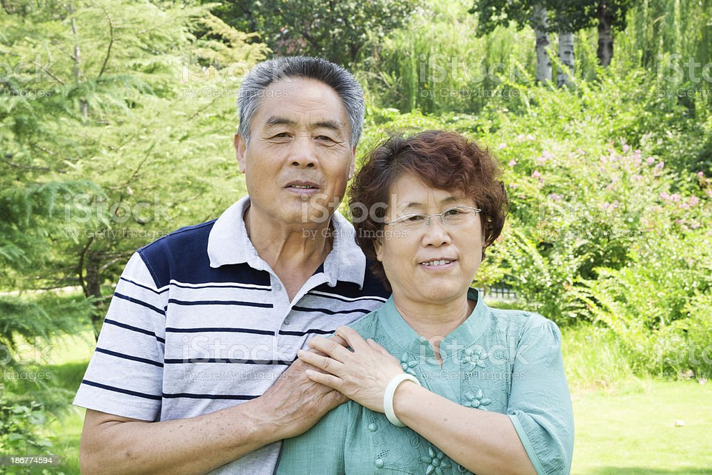 Senior asian couple:smiling and loving royalty-free stock photo