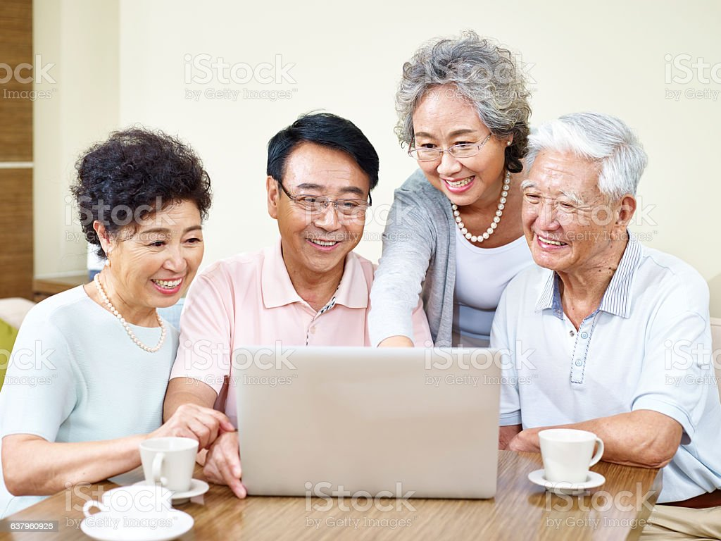 senior asian friends gathering at home stock photo