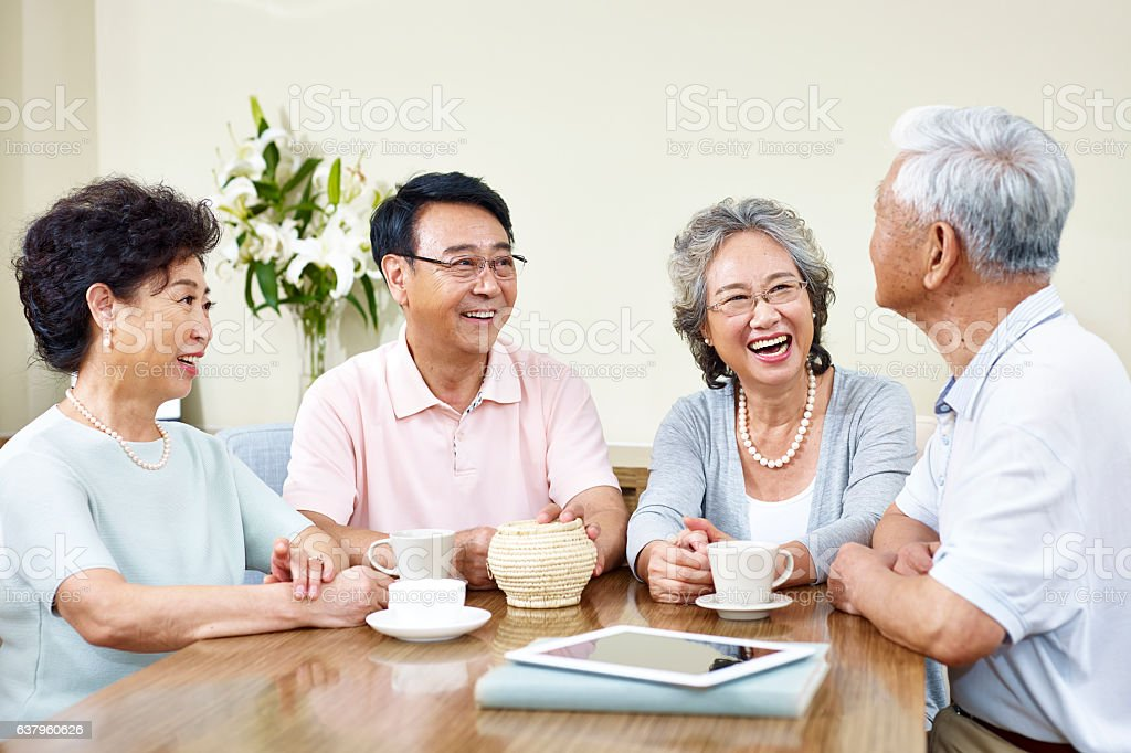 senior asian friends relaxing chatting at home ストックフォト