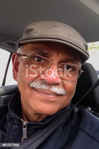 istock Senior Asian Man Belted in on Drivers Seat - iPhone Camera Selfie 661047558
