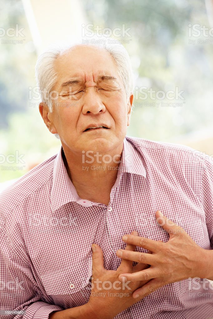 Senior Asian man with chest pain royalty-free stock photo
