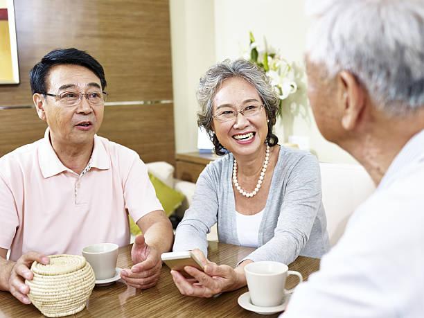 senior asian people chatting - 談笑する ストックフォトと画像