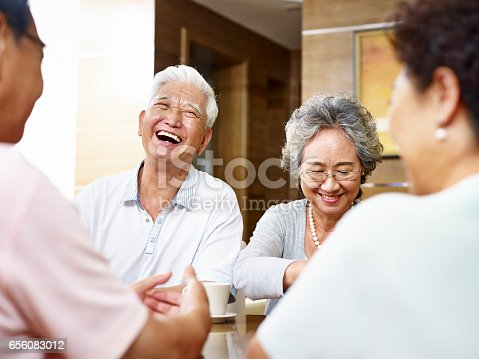istock senior asian people gathering at home 656083012