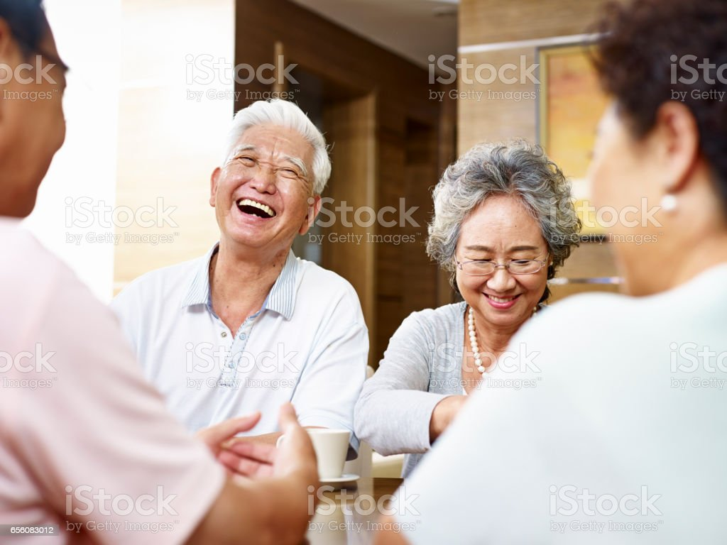 senior asian people gathering at home stock photo