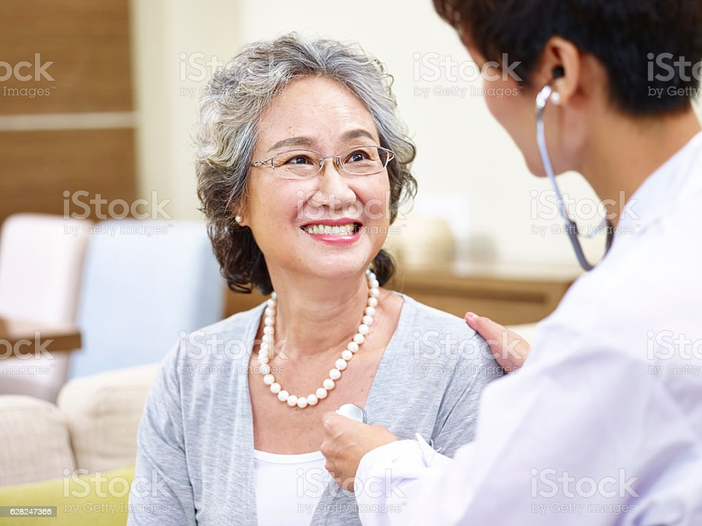 senior asian woman having a physical check stock photo