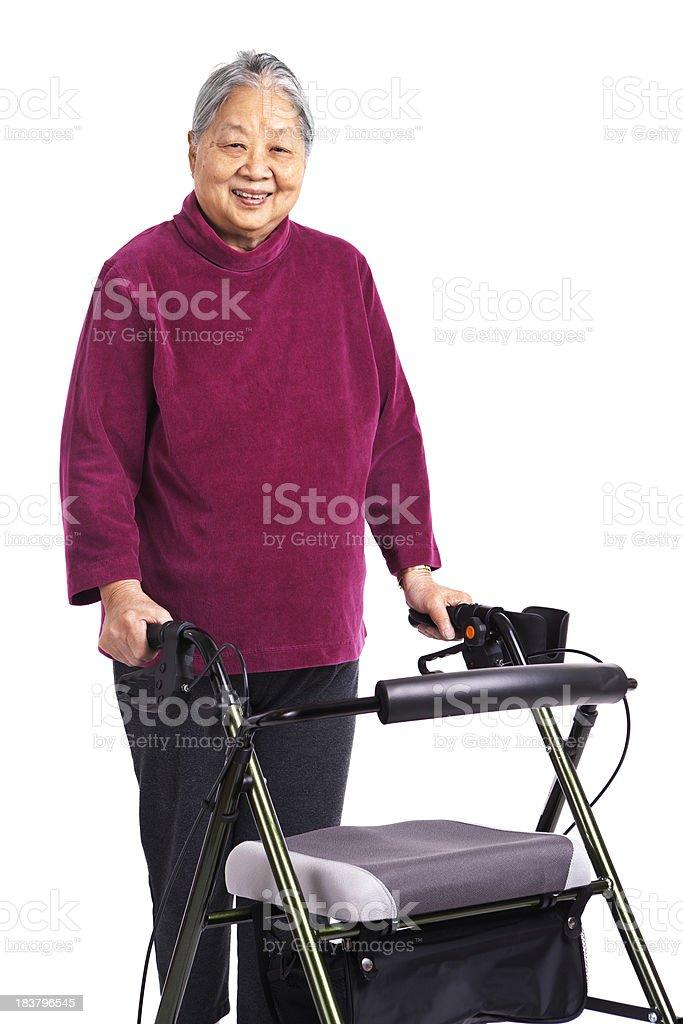 Senior Asian Woman Holding Orthopedic Walker, Close-up on White Background royalty-free stock photo