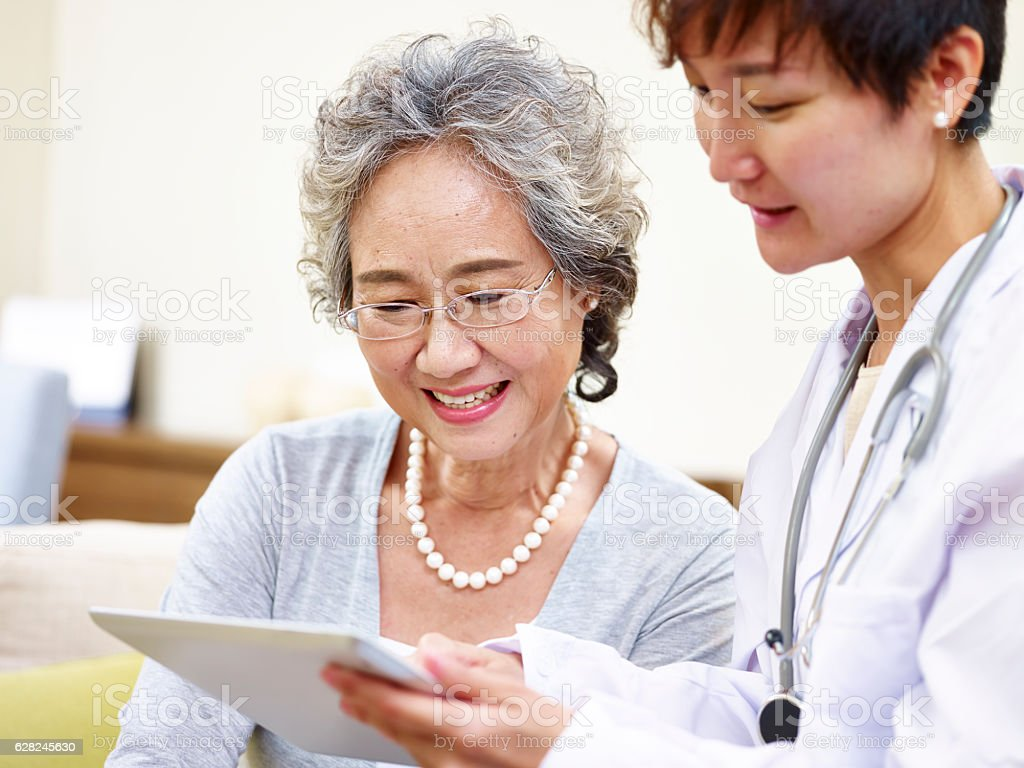 senior asian woman seeing family doctor stock photo