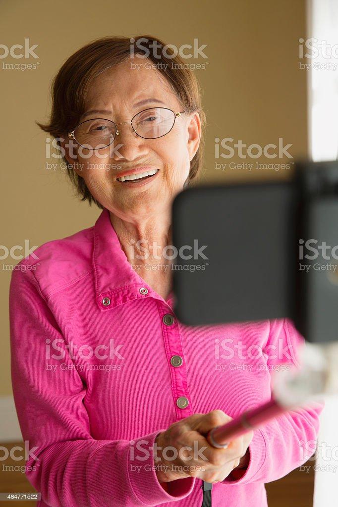Senior Asian Woman Taking a Selfie stock photo