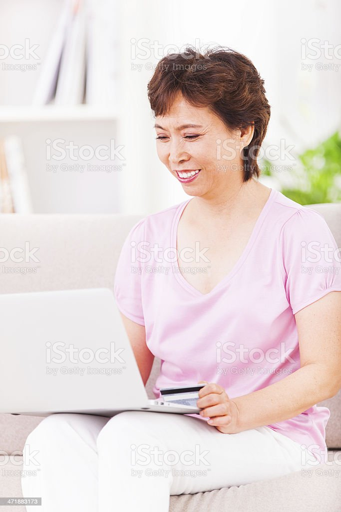 Senior asian woman using laptop royalty-free stock photo