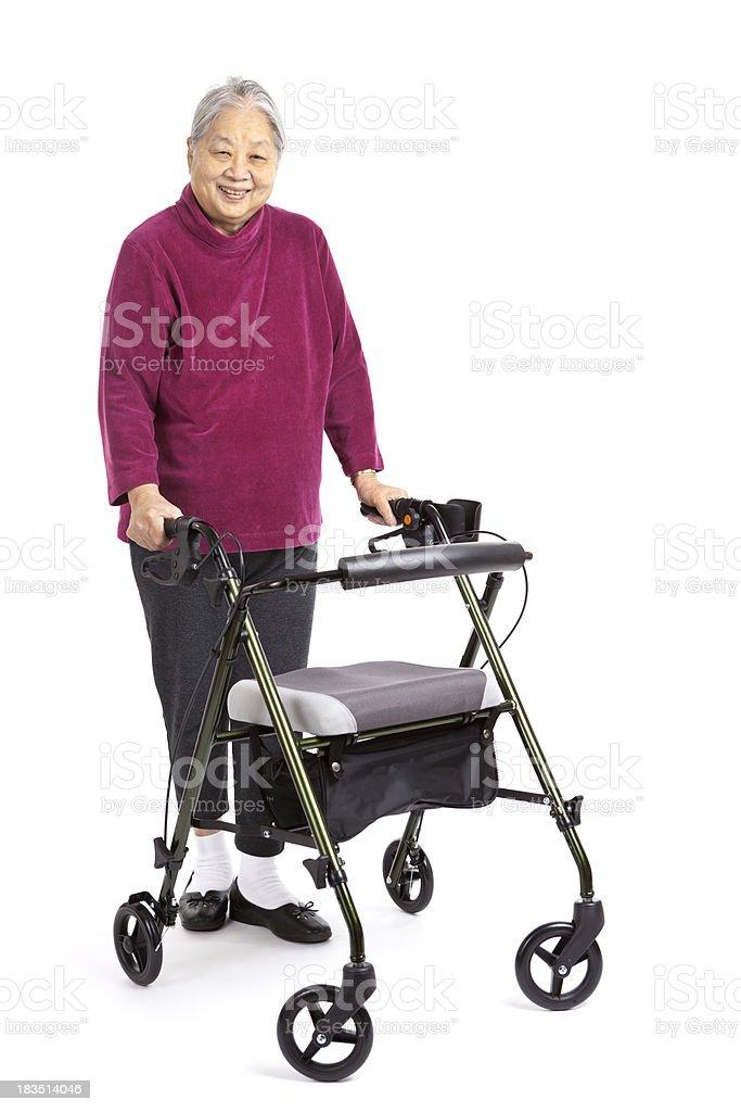 Senior Asian Woman Using Orthopedic Walker, Front View, White Background圖像檔