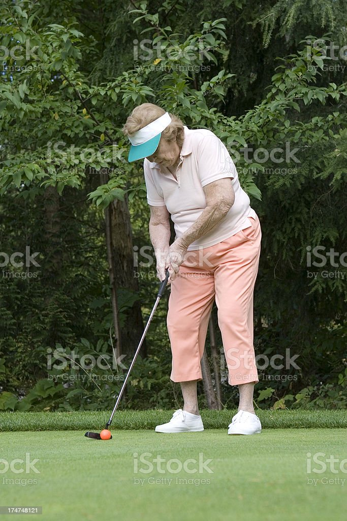 Senior at the golf course royalty-free stock photo