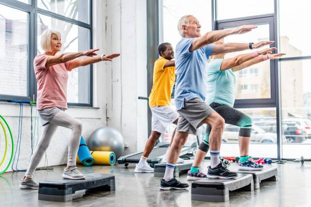 Senior athletes synchronous exercising on step platforms at gym picture id1088958514?b=1&k=6&m=1088958514&s=612x612&w=0&h=l wxyb3wwe2qchqjkddn8vor6vm9k5a6opwssb5l3z0=