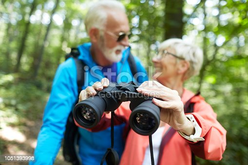 Active senior couple having a great time during outdoors hiking adventure.