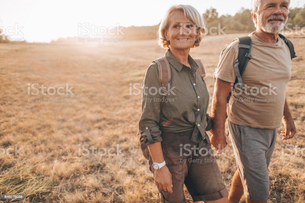 Senior backpackers stock photo