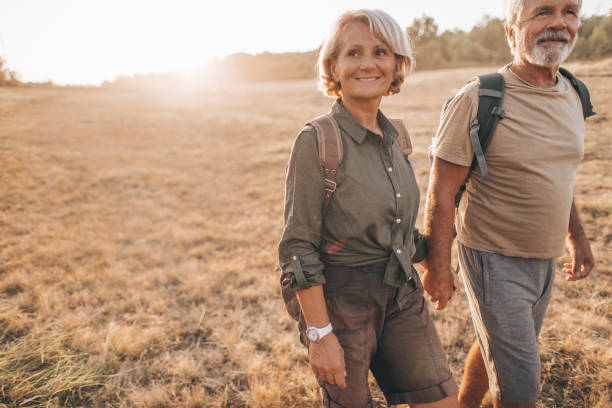 Senior backpackers stock photo