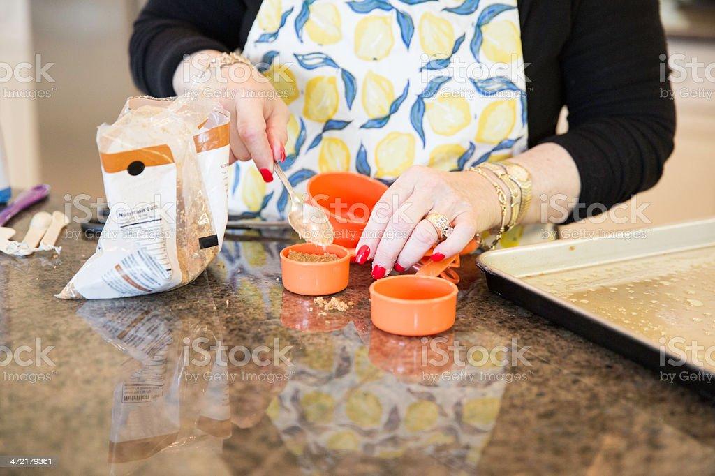 Senior Baking series-adding the brown sugar royalty-free stock photo