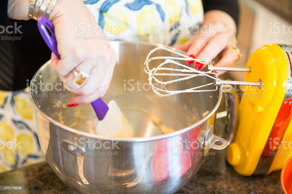Senior Baking series-mixing the ingredients royalty-free stock photo