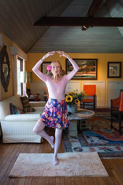 Senior ballerina in classic pose stock photo