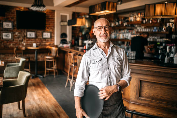 Senior barista in cafe stock photo