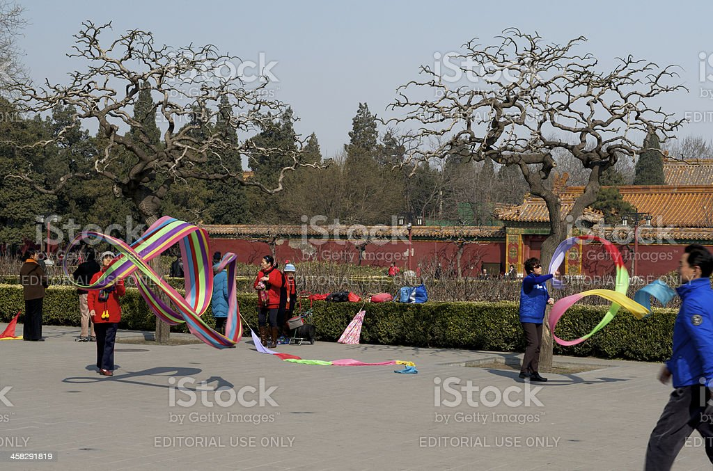 Senior Beijing citizens are doing ribbon dancing as morning exercise royalty-free stock photo
