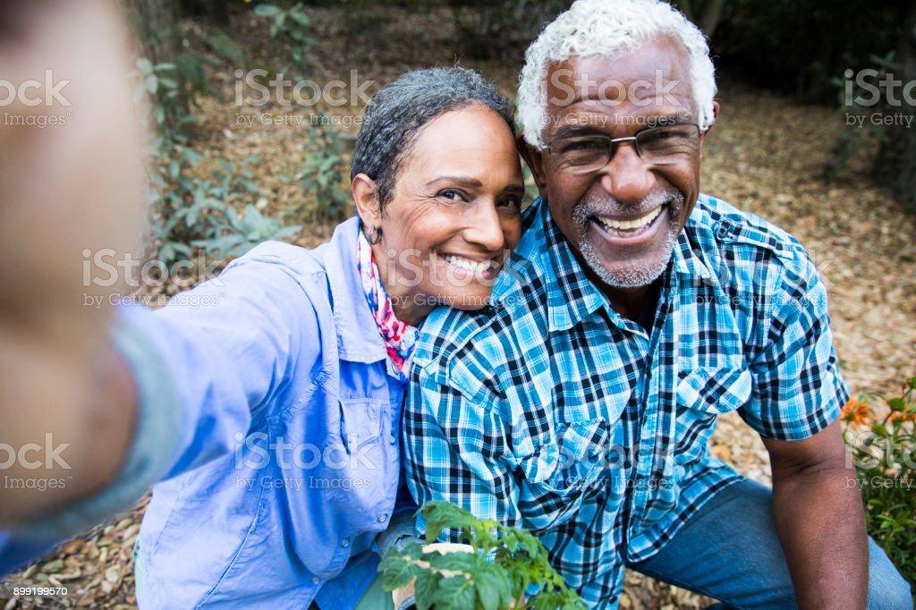 Senior Black Couple Gardening Taking a Selfie stock photo