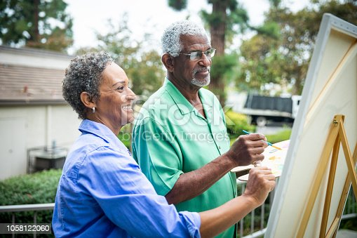 istock Senior Black Couple Painting on Canvas 1058122060