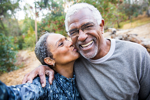 istock Senior Black Couple Taking Selfie During Exercise 898430744