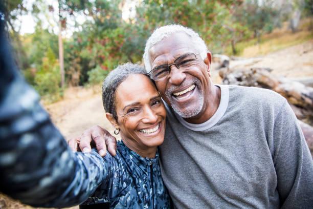 Senior Black Couple Taking Selfie During Exercise stock photo