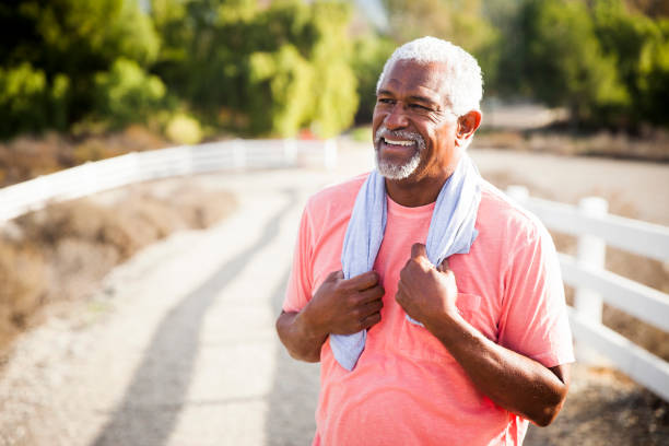 senior black man after workout - breathing exercise stock pictures, royalty-free photos & images