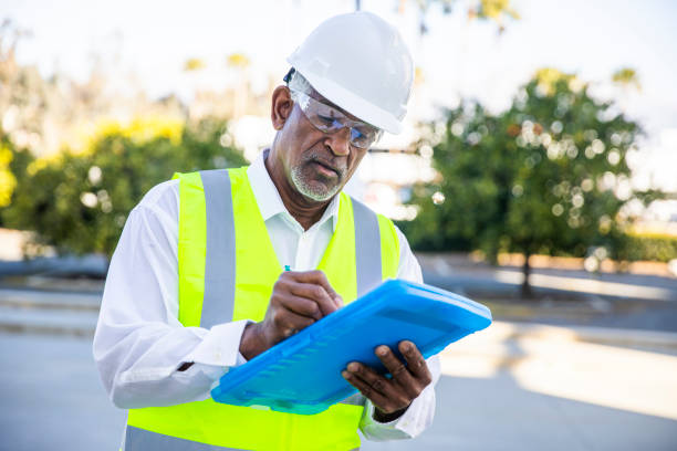 Senior Black Man Construction Manager Inspection stock photo