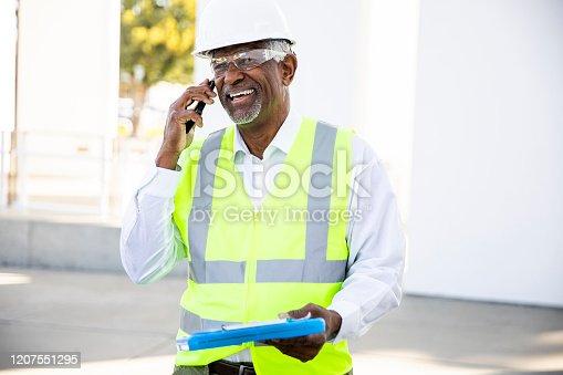 1054724700 istock photo Senior Black Man Construction Manager on Phone call 1207551295