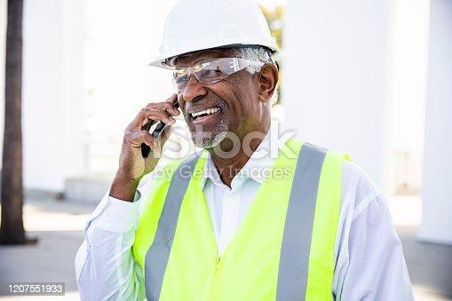 1054724700 istock photo Senior Black Man Construction Manager on Phone call 1207551933