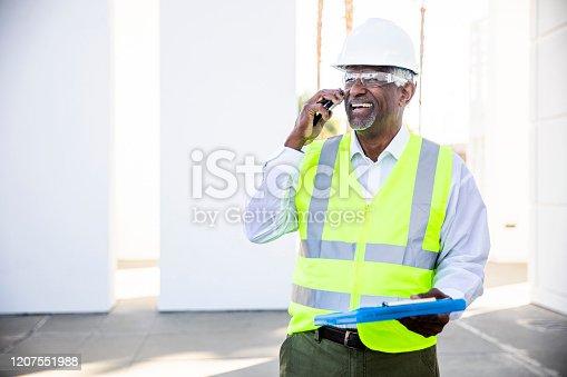 1054724700 istock photo Senior Black Man Construction Manager on Phone call 1207551988