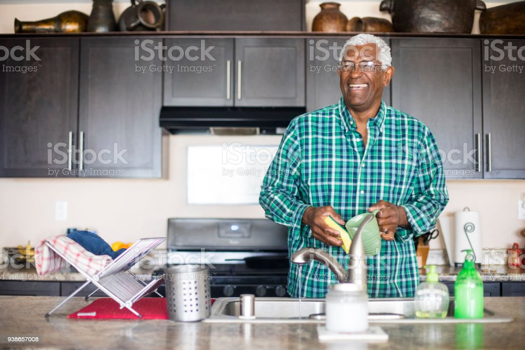 Senior Black Man Cooking Breakfast in Kitchen stock photo