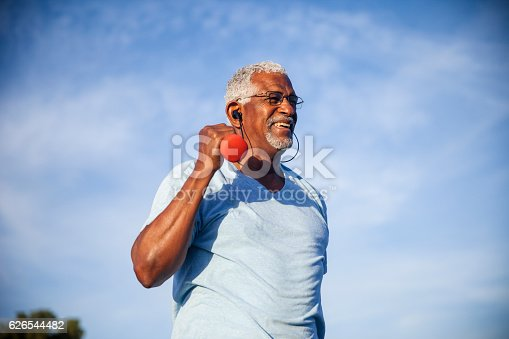 istock Senior Black Man Exercising Outdoors with Dumbells 626544482
