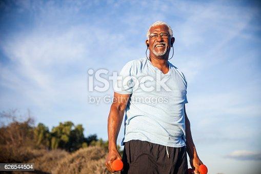 istock Senior Black Man Exercising Outdoors with Dumbells 626544504