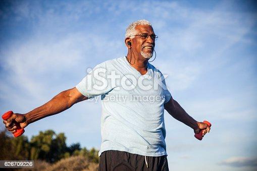 istock Senior Black Man Exercising Outdoors with Dumbells 626709226