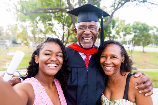 Senior Black Man Graduate with Family stock photo