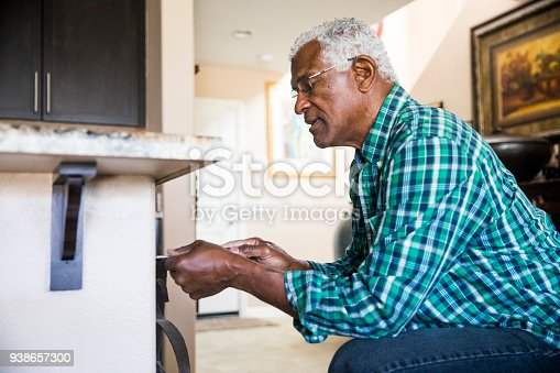 istock Senior Black Man Home Repairs 938657300