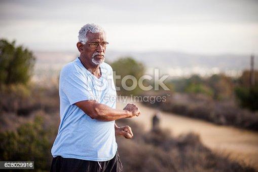 istock Senior Black Man Stretching and Exercising Outdoors 628029916