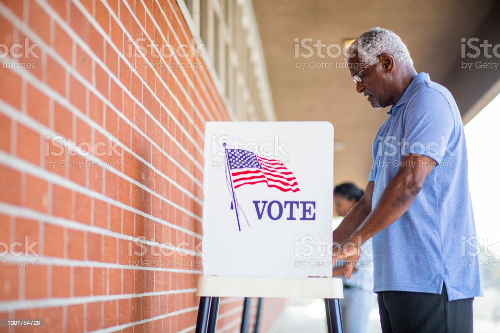 Senior Black Man Voting stock photo