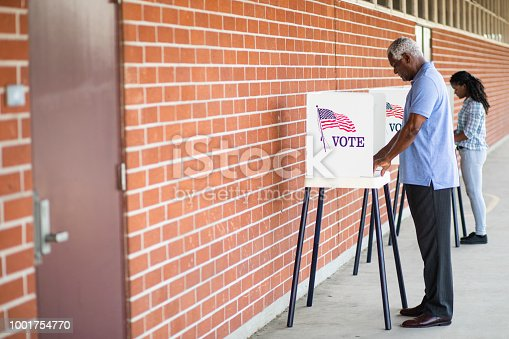 1001757174 istock photo Senior Black Man Voting 1001754770