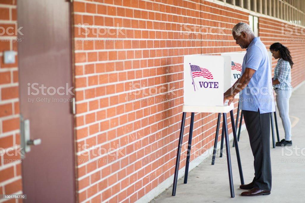Senior Black Man Voting stock photo