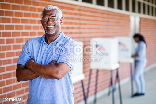 1001757174 istock photo Senior Black Man Voting Portrait 1001754638