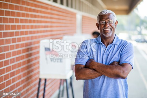1001757174 istock photo Senior Black Man Voting Portrait 1001754722