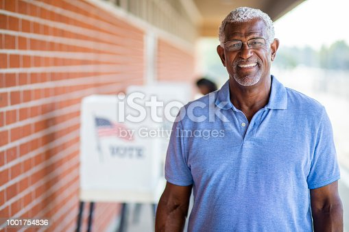 1001757174 istock photo Senior Black Man Voting Portrait 1001754836