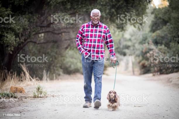Senior black man walking his dog picture id1149947884?b=1&k=6&m=1149947884&s=612x612&h=crhkiogygpwsxiwjc4c5bbalbvrhkqdyr9tc qzanam=