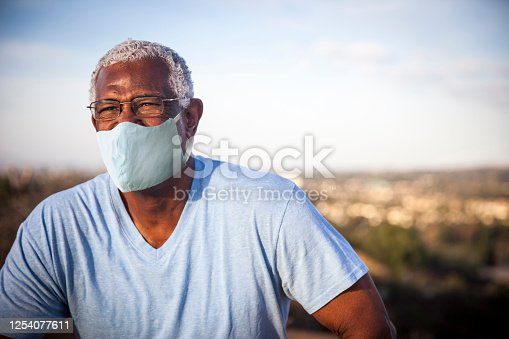 626367626 istock photo Senior Black Man Wearing a Mask Outdoors 1254077611