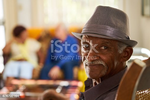 istock Senior Black Man With Hat Looking At Camera In Hospice 626702164