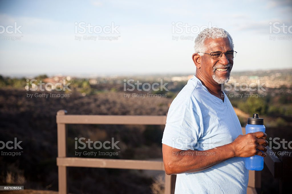 Senior Black Man with Water Bottle stock photo